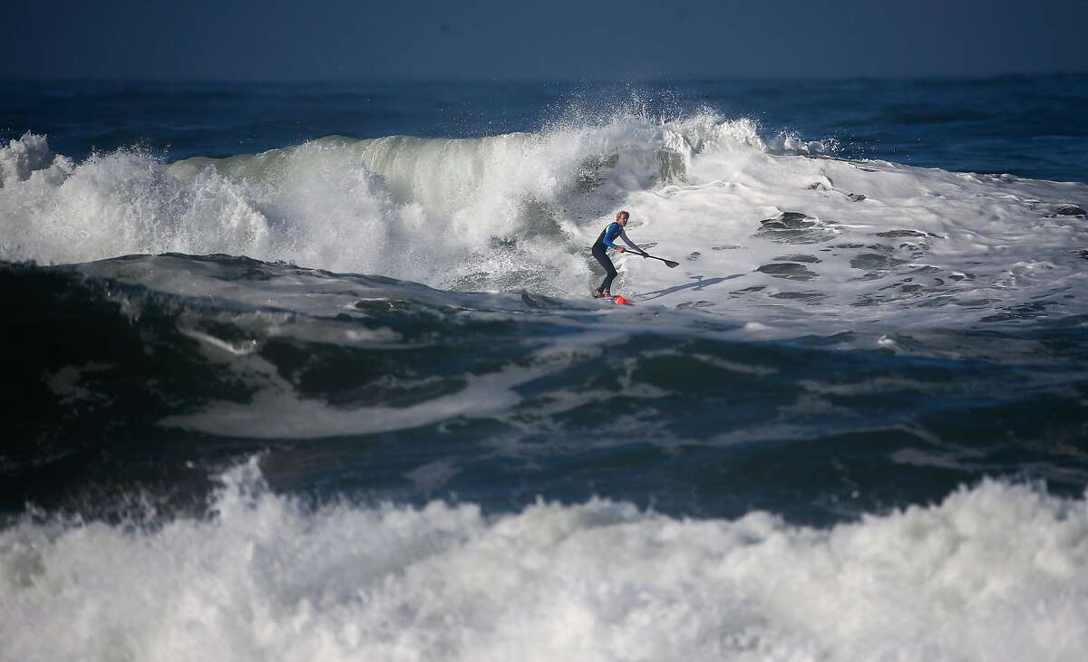 With the competition postponed until Wednesday Connor Baxter gets in a little practice in the surf off Ocean Beach on Tuesday October 18, 2016, to prepare for the Red Bull Heavy Water Stand Up Paddle Board competition in San Francisco, California.