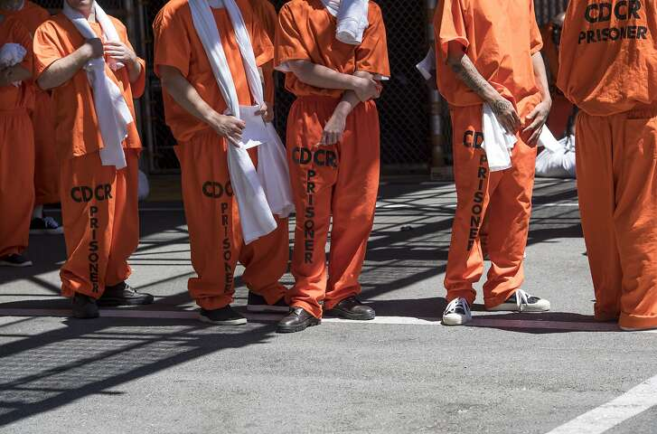 Inmates stand outside at San Quentin State Prison in San Quentin, California, U.S., on Tuesday, Aug. 16, 2016. San Quentin, home to the state's only death row, houses 725 condemned inmates. On the November 8th California ballot voters have the chance to abolish the death penalty or speed up the process. Photographer: David Paul Morris/Bloomberg