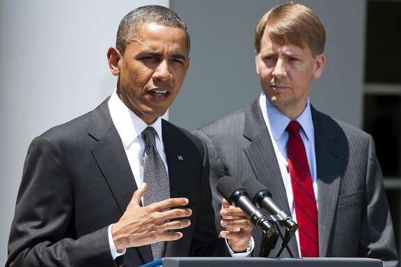 """U.S. President Barack Obama announces his nomination of former Ohio Attorney General Richard Cordray, right, to head the Consumer Financial Protection Bureau at the White House in Washington, D.C., U.S., on Monday, July 18, 2011. Obama said his nomination of Cordray to head the bureau puts financial lenders on notice that the government will be looking out for """"regular people."""" Photographer: Joshua Roberts/Bloomberg *** Local Caption *** Barack Obama; Richard Cordray"""
