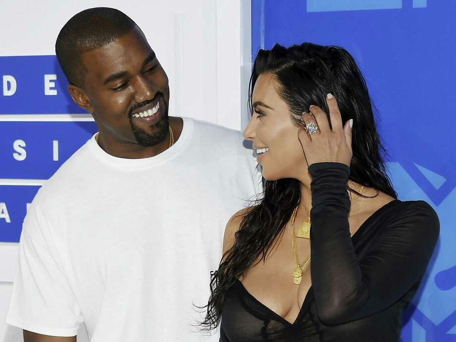 FILE - In this Aug. 28, 2016 file photo, Kanye West, left, and Kim Kardashian West arrive at the MTV Video Music Awards in New York. Armed robbers forced their way into a private Paris residence early Monday, Oct. 3, where Kim Kardashian West was staying and tied her up, police officials said. They said five assailants, who are still at large, stole a jewelry box containing valuables worth 6 million euros ($6.7 million) as well as a ring worth 4 million euros ($4.5 million.) (Photo by Evan Agostini/Invision/AP, File) Photo: Evan Agostini, INVL / Associated Press / ©2016 Evan Agostini