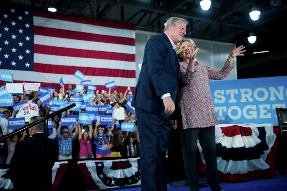 Hillary Clinton and former Vice President Al Gore spoke of a warming planet during a recent campaign event in Miami, but don't expect the topic of climate change to crop up during Wednesday's presidential debate.  Photo: DOUG MILLS, STF / NYTNS