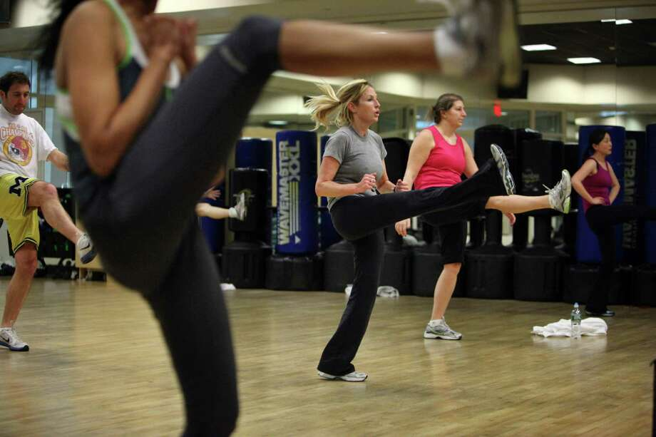 FILE -- A thirty minute Kickboxing Express class at the Reebok Sports Club in New York, Jan. 25, 2011. Equinox Fitness, the purveyor of expensive workout centers and risque advertising, plans to announce as soon as Monday, July 28, 2014, that it has acquired Sports Club/LA gyms in New York and four other cities, as well as the Reebok Sports Club/NY gym on the Upper West Side of Manhattan. (Richard Perry/The New York Times) Photo: RICHARD PERRY, STF / NYTNS