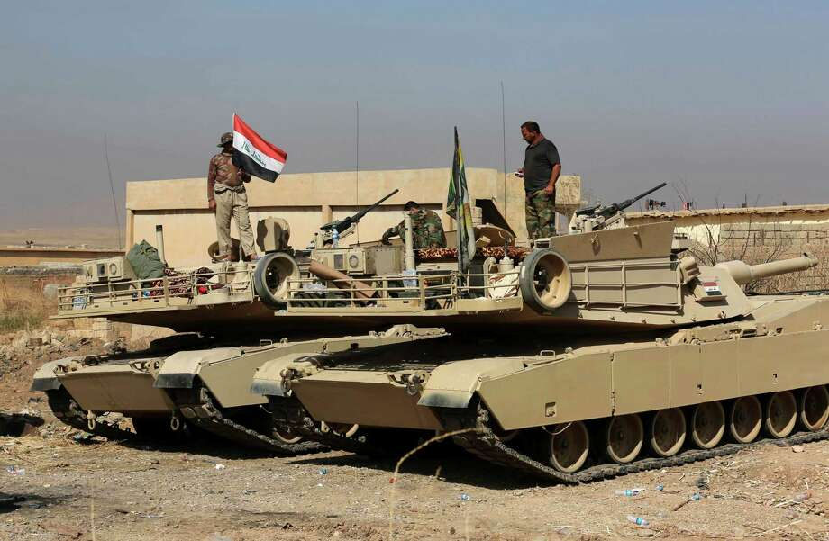 Iraqi forces are deployed during an offensive to retake Mosul from Islamic State militants outside Mosul, Iraq, Monday, Oct. 17, 2016. Columns of Iraqi and Kurdish forces backed by U.S.-led airstrikes slowly advanced on Mosul from several directions on Monday, launching a long-awaited operation to retake Iraq's second largest city from the Islamic State group. (AP Photo/Khalid Mohammed) Photo: Khalid Mohammed, STF / Copyright 2016 The Associated Press. All rights reserved.