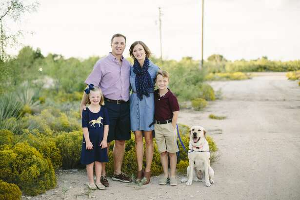 The Ham family, Emery, from left, Justin, Jill and Carson, pose with Emery's canine companion, Piper.