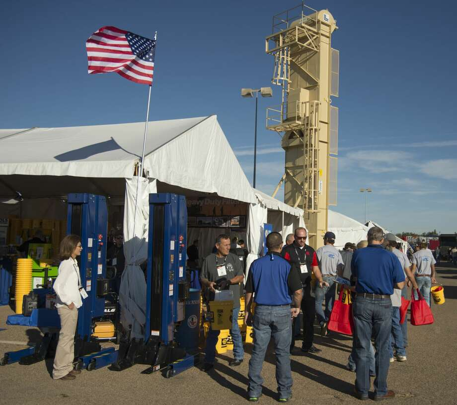 Attendees to the 2016 Permian Basin International Oil Show talk with vendors from around the world Tuesday 10-18-16. Tim Fischer/Reporter-Telegram Photo: Tim Fischer/Midland Reporter-Telegram