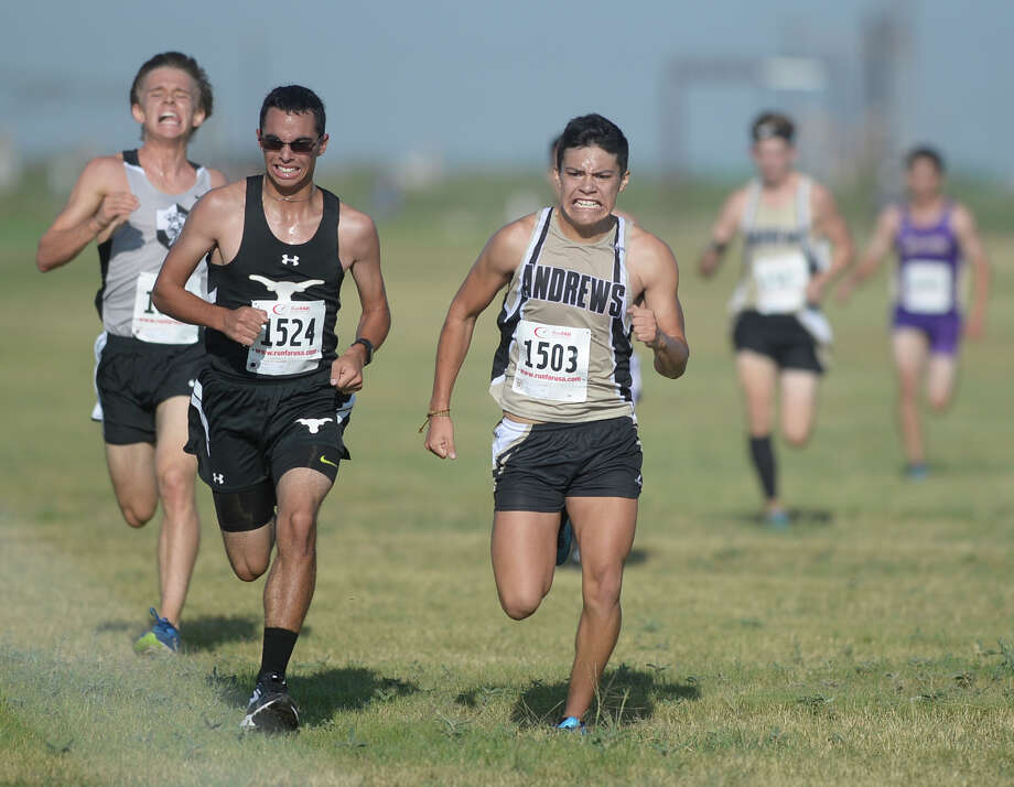 Big Spring's Eric Stinson battles for eighteenth place against Andrews' Alvaro Hernandez in the Boys Division I race during the Tall City Cross-Country Invitational on Saturday, Aug. 27, 2016, at the Rock the Desert festival field.  James Durbin/Reporter-Telegram Photo: James Durbin