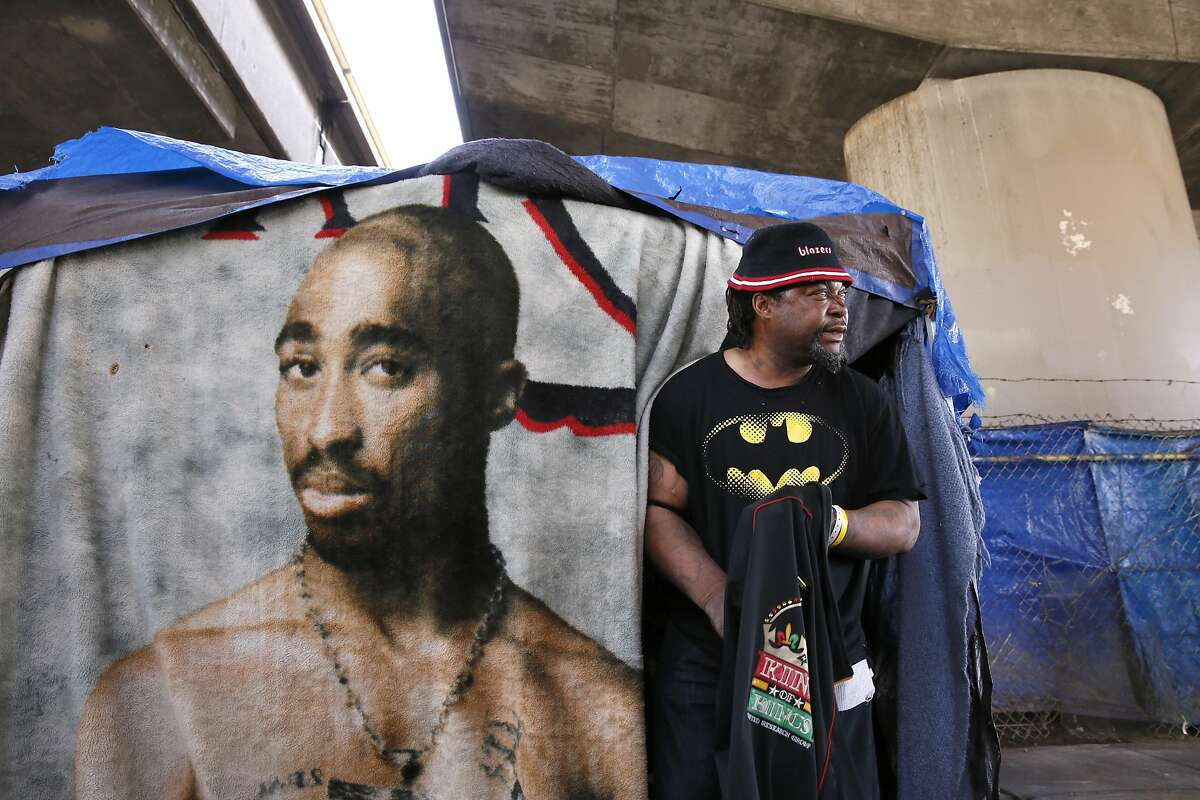 Campanella Martin exits his tent on Tuesday October 18, 2016, a day after the city of Oakland installed several amenities including portable toilets, a hand washing station and garbage and recycling cans at a homeless encampment under the I-580 freeway in West Oakland.