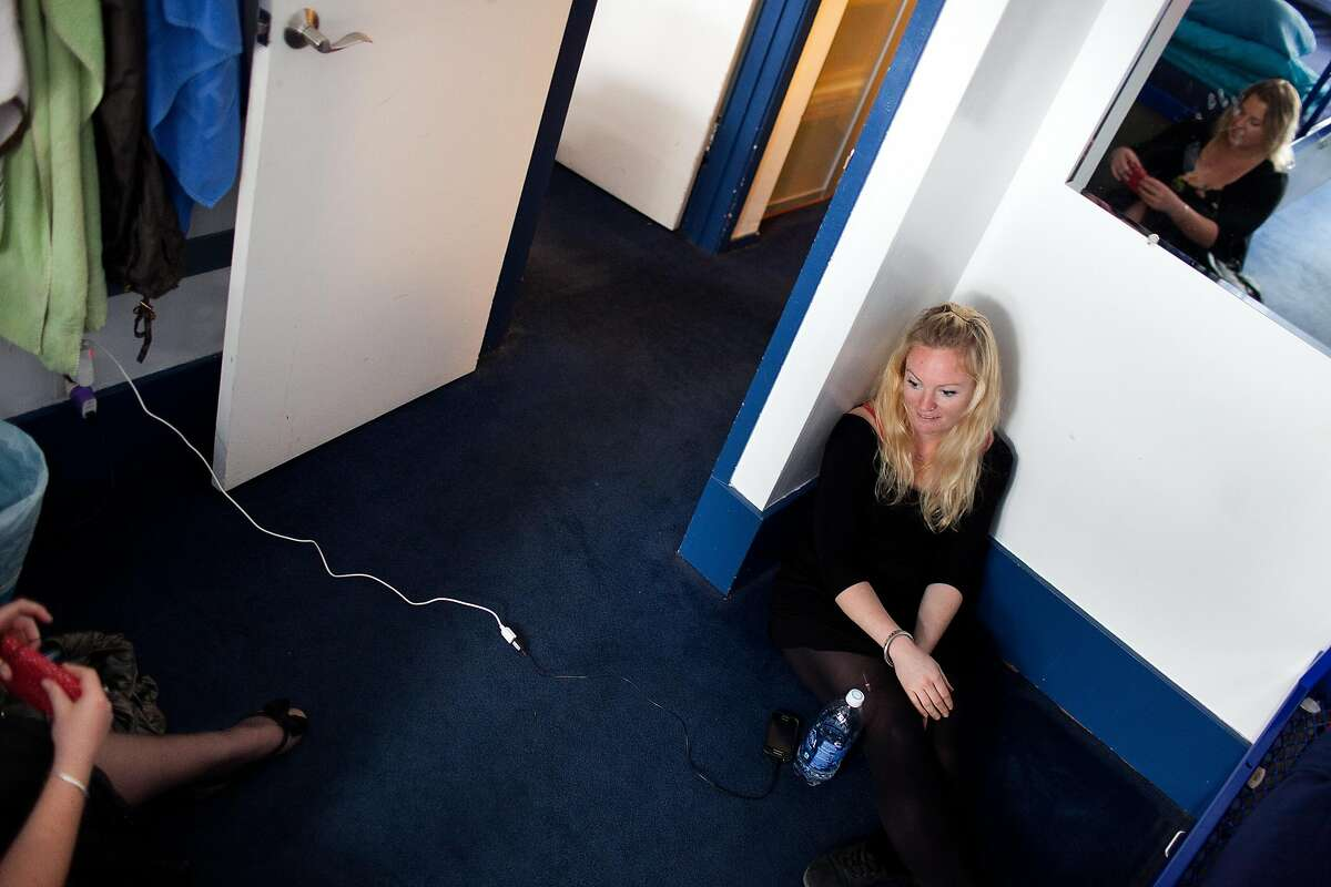 Louise Monticone, of Australia, talks to Emily Brouwer, of New Zealand, left, at Pacific Tradewinds hostel in San Francisco, Calif. on Monday, June 2, 2014. Hostel owner Darren Overby noticed guests needing a place to code and collaborate so he opened RockIT CoLabs around the corner from the hostel. He lists the hostel as an International Hacker Hostel on Airbnb, offering guests the opportunity to use RockIT CoLabs as part of their stay.