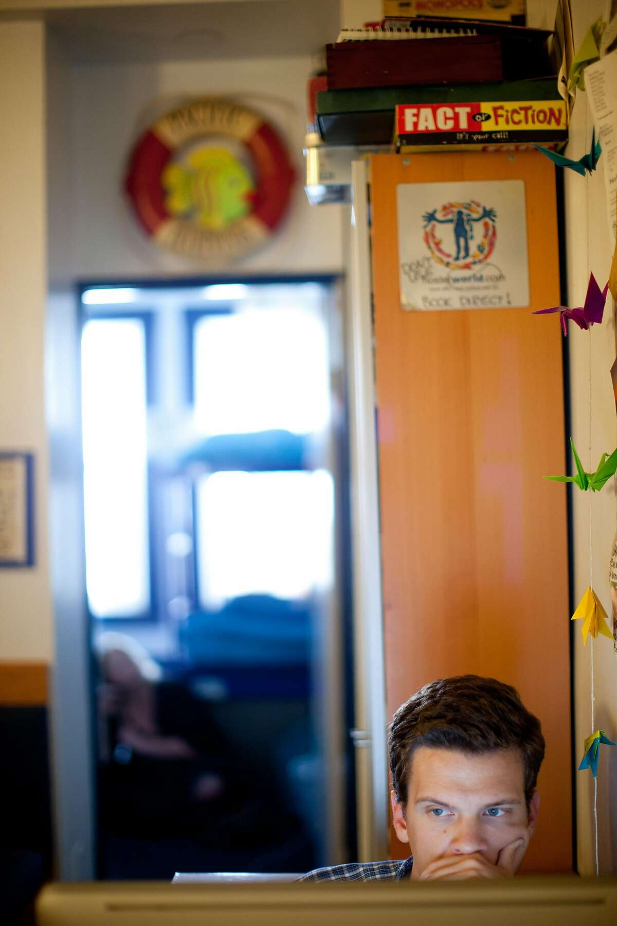 George Marshall, of Arizona, uses the internet at Pacific Tradewinds hostel in San Francisco, Calif. on Monday, June 2, 2014. Hostel owner Darren Overby noticed guests needing a place to code and collaborate so he opened RockIT CoLabs around the corner from the hostel. He lists the hostel as an International Hacker Hostel on Airbnb, offering guests the opportunity to use RockIT CoLabs as part of their stay.