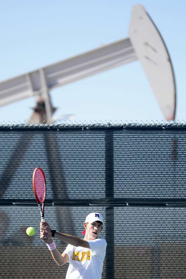 Midland High's Cole Carriger competes in a No. 3 singles match against Lee's Matthew Hall (not pictured) on Tuesday, Oct. 4, 2016, at Bush Tennis Center. James Durbin/Reporter-Telegram Photo: James Durbin