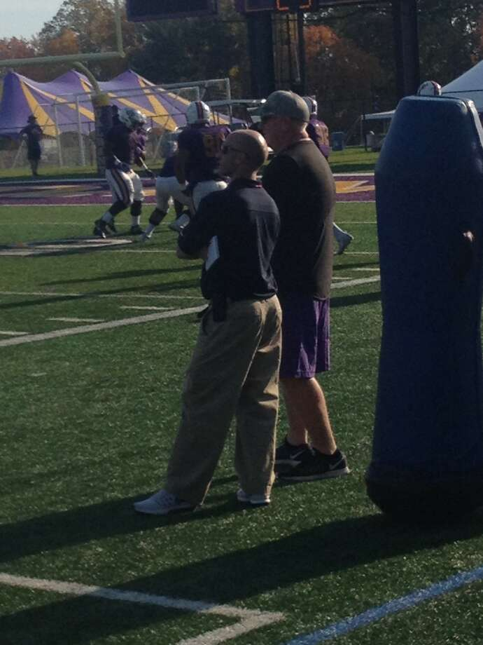 A New England Patriots scout, left, visited UAlbany football practice this afternoon. He chatted with Great Danes head coach Greg Gattuso. (Mark Singelais)