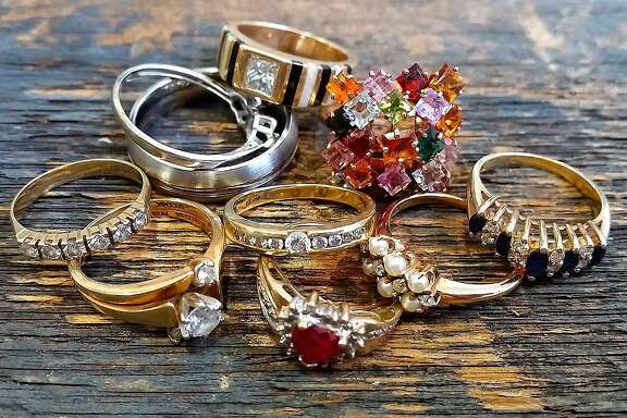 Donated rings, including Marirose Piciucco's engagement ring and wedding band is on the bottom left.