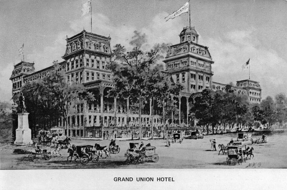 "Saratoga Springs Grand Union Hotel Post Card. Photo hand-colored by George S. Bolster in 1975. ""Grand Union Hotel 1870 - One this site in 1802 was erected Gideon Putnam's Tavern - later known as Union Hall. Remodeled into a brick structure, it contained 824 rooms - boasted of 1 mile of piazzas, 2 miles of hallways and 12 acres of carpet. At the time, it was considered the largest hotel in the world."" (Times Union Archive)"
