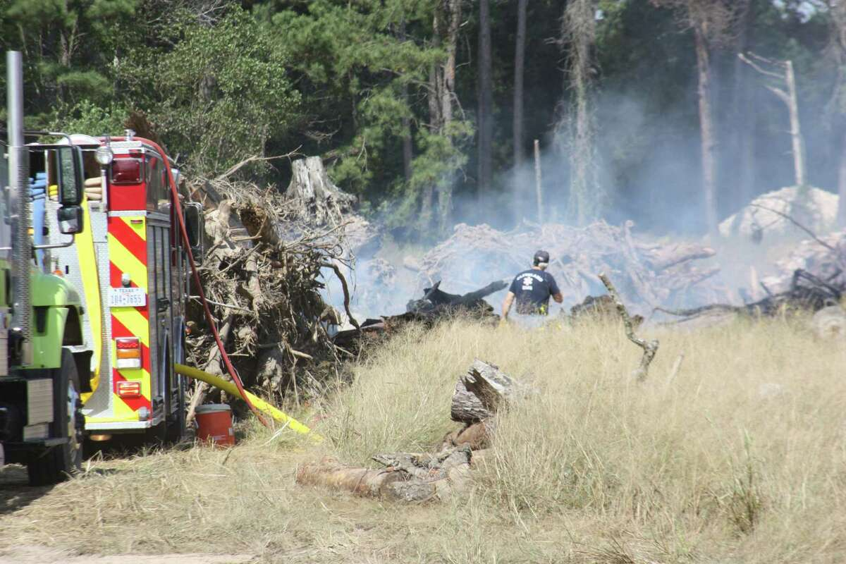 Firefighters from five departments in Liberty County responded to a call for help at the Texas Tech Inc. dump site on Tuesday, Oct. 18. Authorities say several loads of construction debris had intentionally been ignited and the fire was threatening nearby homes because of dry conditions and the volume of available fuel on the ground.