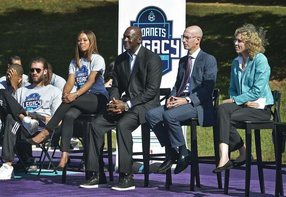 Hornets owner Michael Jordan (center) with Commissioner Adam Silver (second from right) and Mayor Jennifer Roberts (right) attend the dedication of basketball courts in Charlotte, N.C. Photo: Davie Hinshaw, Associated Press