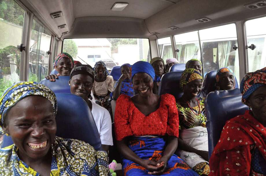 Family members of the Nigerian Chibok kidnapped girls share a moment as they depart to the Nigerian minister of women affairs in Abuja, Nigeria, Tuesday, Oct. 18, 2016. Nigeria's government is negotiating the release of another 83 of the Chibok schoolgirls taken in a mass abduction two-and-a-half years ago, but more than 100 others appear unwilling to leave their Boko Haram Islamic extremist captors, a community leader said Tuesday.(AP Photo/Olamikan Gbemiga) Photo: Olamikan Gbemiga, STR / Copyright 2016 The Associated Press. All rights reserved.