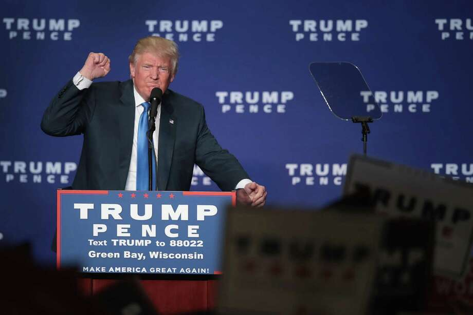 Republican presidential nominee Donald Trump addresses supporters during a campaign stop Monday in Green Bay, Wis. Photo: Scott Olson, Staff / 2016 Getty Images