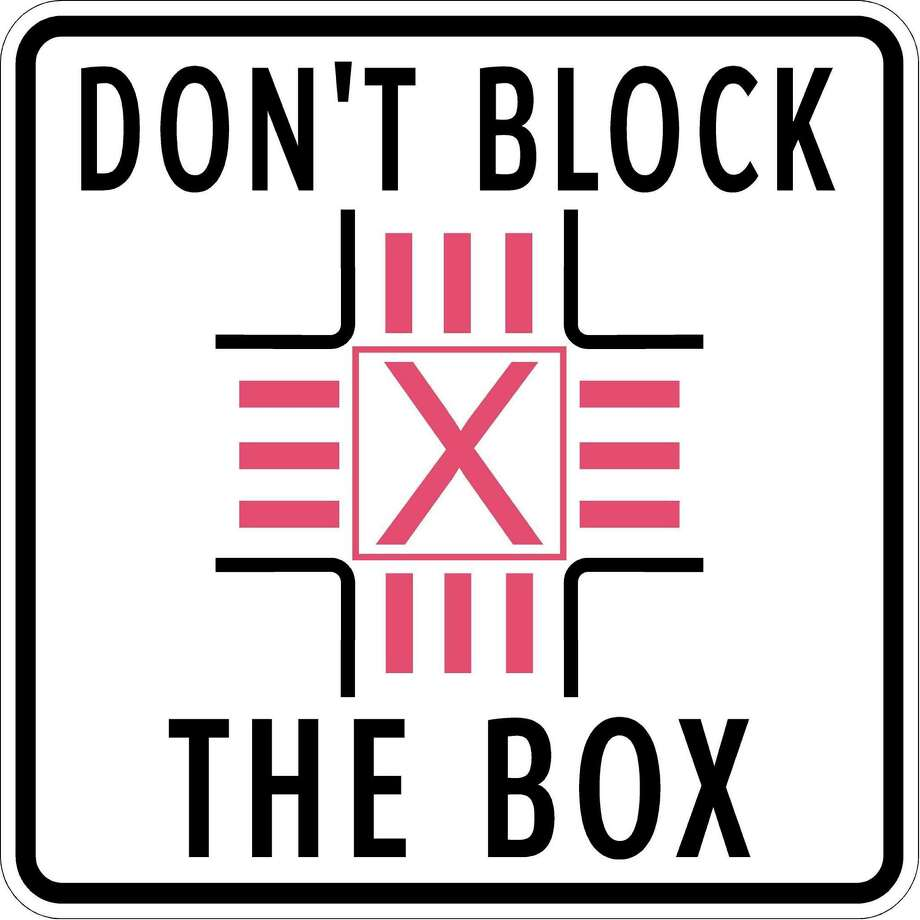 DON'T BLOCK THE BOX sign. Don't stop in intersections. The city is rolling out a pilot program to test whether special signage will reduce the number of drivers who stop in the middle of intersections. Photo: Courtesy