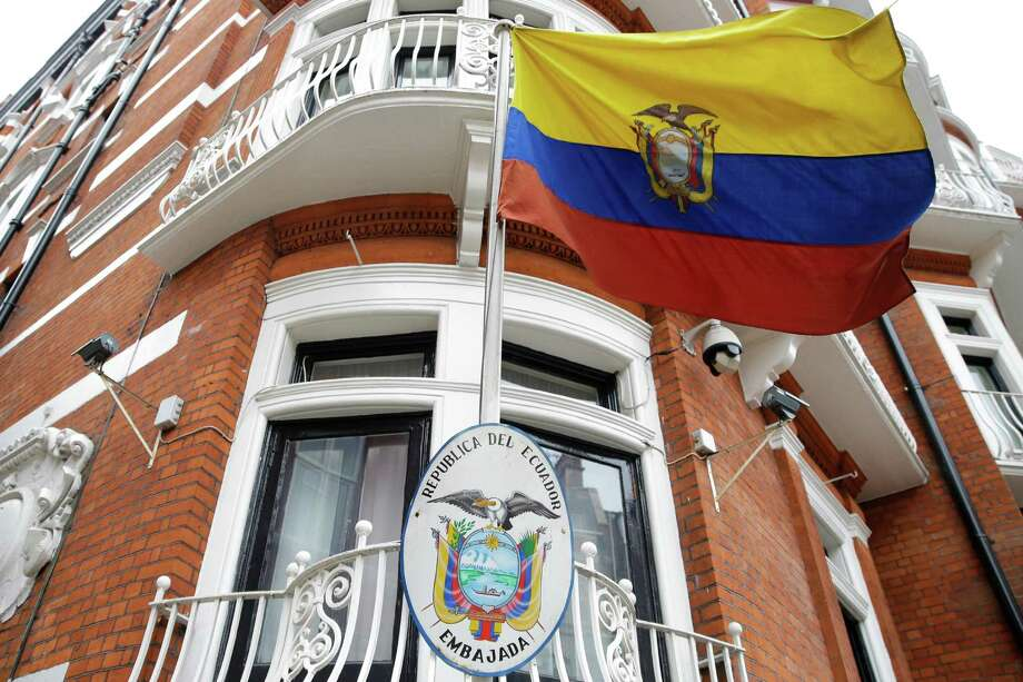 The Ecuadorian national flag flies outside their London Embassy, Tuesday, Oct. 18, 2016. Midway through releasing a series of damaging disclosures about U.S. presidential contender Hillary Clinton, WikiLeaks founder Julian Assange says his hosts at the Ecuadorean Embassy in London abruptly cut him off from the internet. The news adds another layer of intrigue to an extraordinary campaign. (AP Photo/Alastair Grant) Photo: Alastair Grant, STF / Copyright 2016 The Associated Press. All rights reserved.