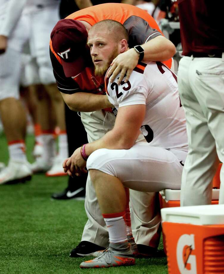 Virginia Tech kicker Joey Slye sits on the sideline after missing a field goal during the first half of an NCAA college football game against Syracuse, Saturday, Oct. 15, 2016, in Syracuse, N.Y. (AP Photo/Mike Groll) ORG XMIT: NYMG113 Photo: Mike Groll / Copyright 2016 The Associated Press. All rights reserved.