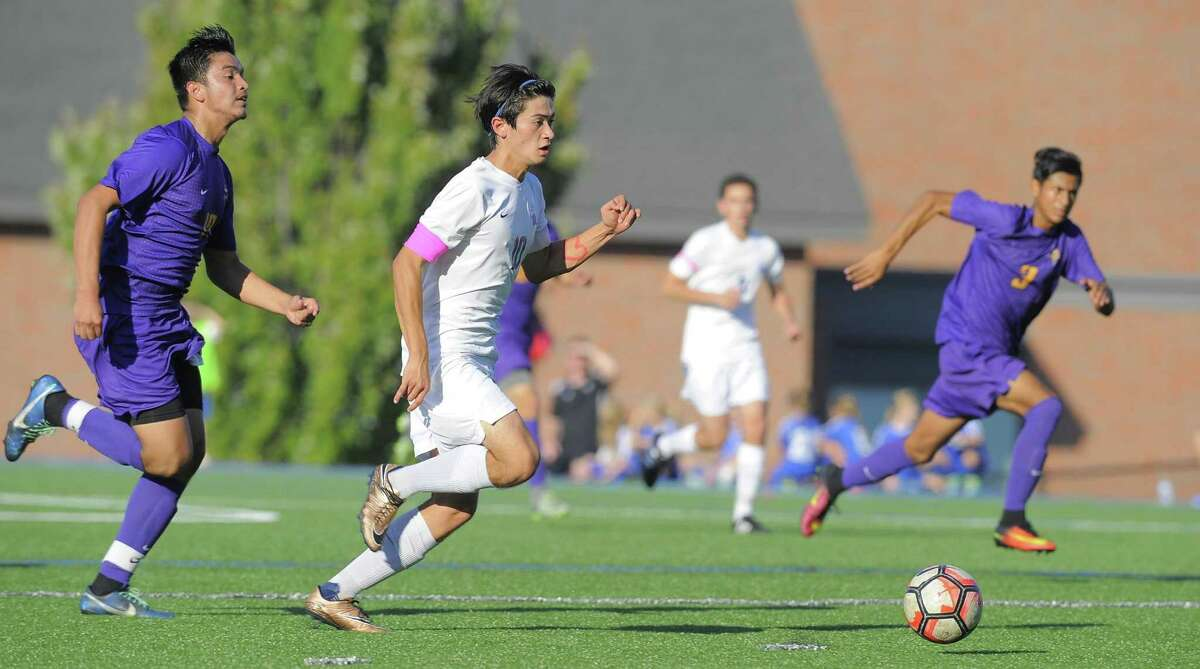 Darien Jason Flynn (10) breaks away from Westhill Carlos Carranza (17) on his way to scoring in the first half of a boys soccer game at Darien High School on Tuesday, Oct. 18 2016. Darien defeated Westhill 2-1.