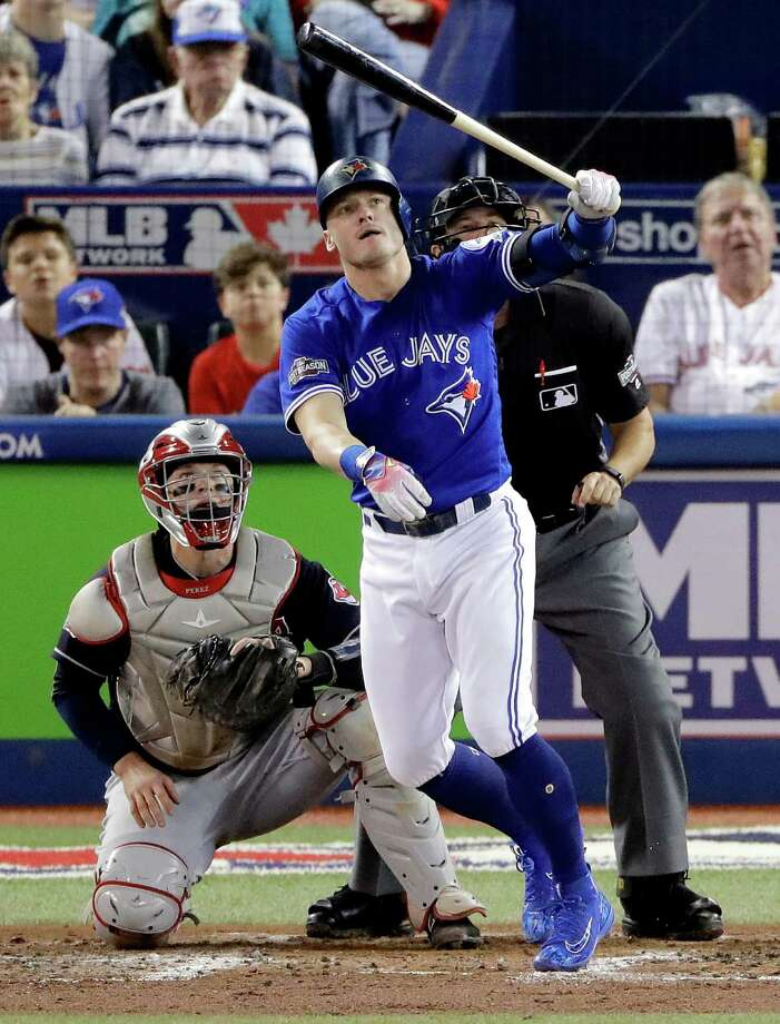 Toronto Blue Jays' Josh Donaldson, watches his home run off Cleveland Indians starting pitcher Corey Kluber during the third inning in Game 4 of baseball's American League Championship Series in Toronto, Tuesday Oct. 18, 2016. (AP Photo/Charlie Riedel) ORG XMIT: ALCS119 Photo: Charlie Riedel / Copyright 2016 The Associated Press. All rights reserved.