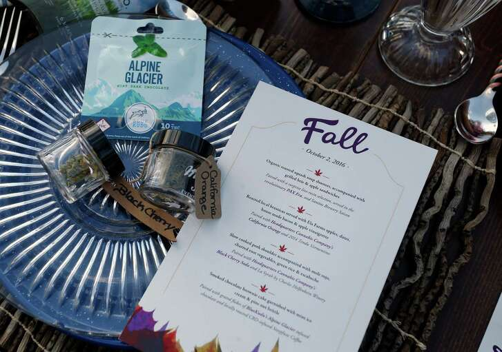 In this Oct. 2, 2016 photo, a menu shows the dishes paired with certain strains of pot during an evening of pairings of fine food and craft marijuana strains served to invited guests dining at Planet Bluegrass, an outdoor venue in Lyons, Colo. Chefs and pot growers trying to explore fine dining with weed face a legal gauntlet to make pot dinners a reality, even where the drug is legal. (AP Photo/Brennan Linsley)