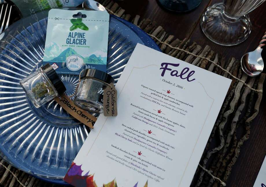 In this Oct. 2, 2016 photo, a menu shows the dishes paired with certain strains of pot during an evening of pairings of fine food and craft marijuana strains served to invited guests dining at Planet Bluegrass, an outdoor venue in Lyons, Colo. Chefs and pot growers trying to explore fine dining with weed face a legal gauntlet to make pot dinners a reality, even where the drug is legal. (AP Photo/Brennan Linsley) Photo: Brennan Linsley, STF / Copyright 2016 The Associated Press. All rights reserved.