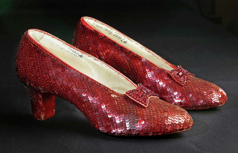 "The sequin-covered ruby slippers worn by Judy Garland in ""The Wizard of Oz""  have faded badly and need to be restored, officials of the National Museum of Natural History say. Photo: Reed Saxon, STF / AP2011"