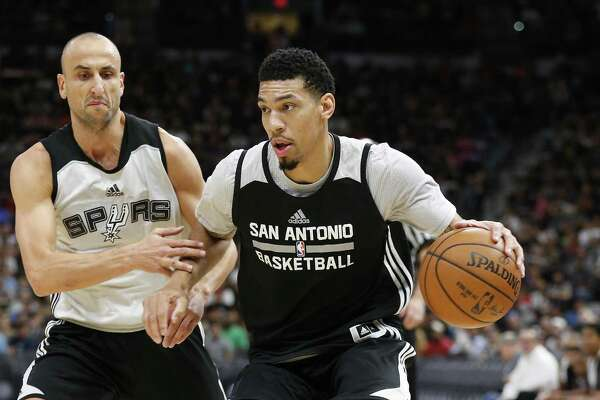 Manu Ginobili (left) pursues teammate Danny Green during the Spurs' Silver & Black open scrimmage at the AT&T Center on Oct. 18, 2016.