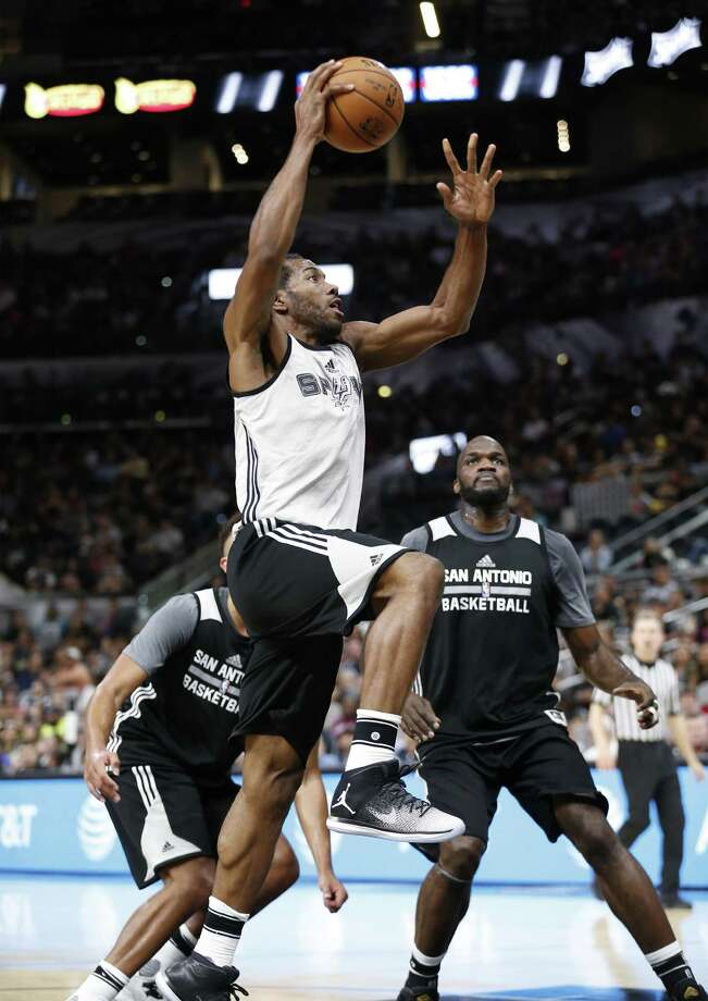 Kawhi Leonard goes up for a shot against Joel Anthony (right) during the Spurs' Silver and Black open scrimmage at the AT&T Center on Tuesday, Oct. 18, 2016. (Kin Man Hui/San Antonio Express-News) Photo: Kin Man Hui /San Antonio Express-News / ©2016 San Antonio Express-News