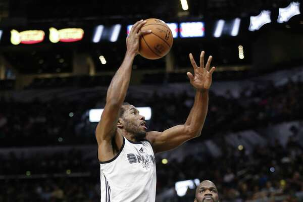Kawhi Leonard goes up for a shot against Joel Anthony (right) during the Spurs' Silver and Black open scrimmage at the AT&T Center on Tuesday, Oct. 18, 2016. (Kin Man Hui/San Antonio Express-News)