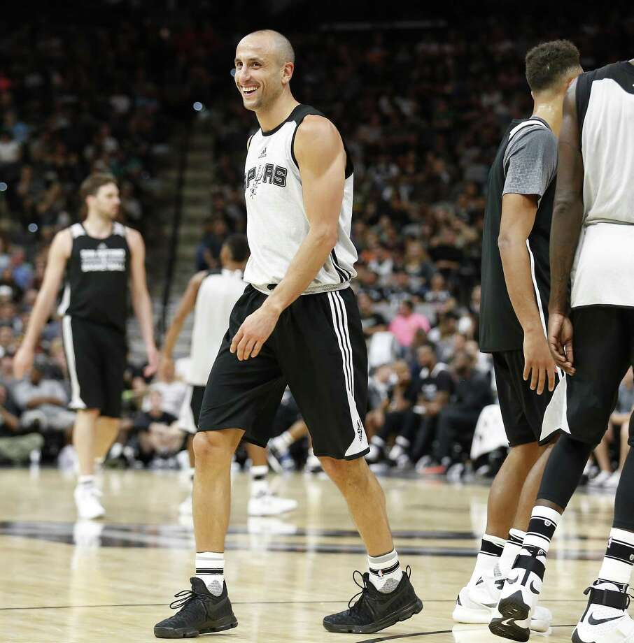 Manu Ginobili smiles after a play during the Spurs' Silver & Black  scrimmage last month. Photo: Kin Man Hui /San Antonio Express-News / ©2016 San Antonio Express-News
