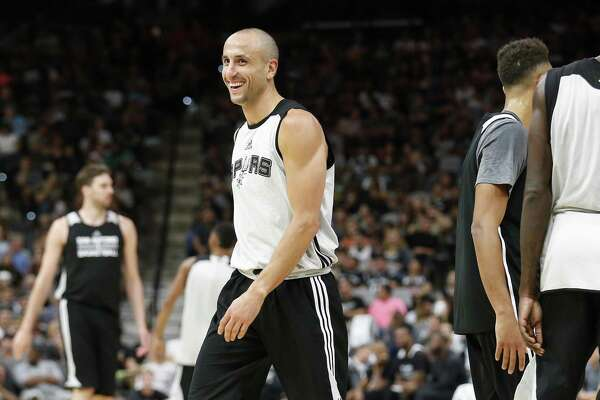 Manu Ginobili cracks a smile after a play during the Spurs' Silver and Black open scrimmage at the AT&T Center on Tuesday, Oct. 18, 2016. (Kin Man Hui/San Antonio Express-News)