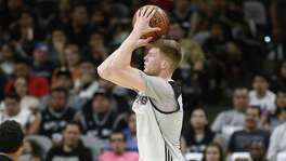 Davis Bertans goes up for a 3-pointer during the Spurs' Silver & Black open scrimmage at the AT&T Center on Oct. 18, 2016.