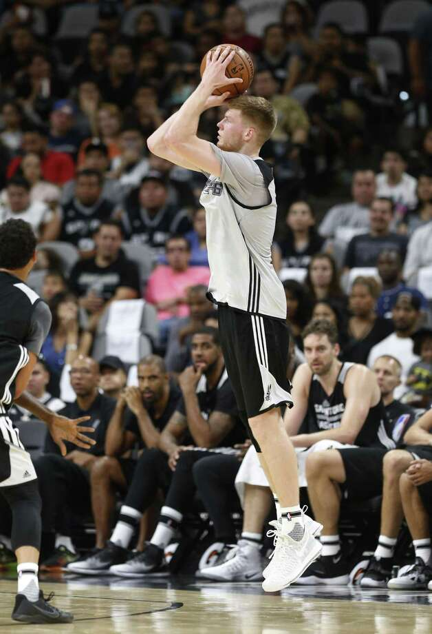 Davis Bertans goes up for a 3-pointer during the Spurs' Silver & Black open scrimmage at the AT&T Center on Oct. 18, 2016. Photo: Kin Man Hui /San Antonio Express-News / ©2016 San Antonio Express-News