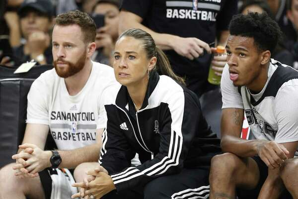 Assistant coach Becky Hammon keeps an eye on the action on the floor during the Spurs' Silver and Black open scrimmage at the AT&T Center on Tuesday, Oct. 18, 2016. (Kin Man Hui/San Antonio Express-News)