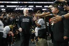 Head coach Gregg Popovich greets fans at the Spurs' Silver and Black open scrimmage at the AT&T Center on Tuesday, Oct. 18, 2016. (Kin Man Hui/San Antonio Express-News)
