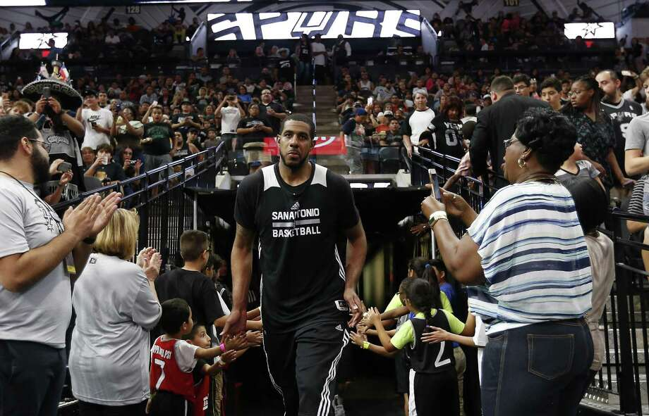 LaMarcus Aldridge greets fans at the Spurs' Silver & Black open scrimmage at the AT&T Center on Oct. 18, 2016. Photo: Kin Man Hui /San Antonio Express-News / ©2016 San Antonio Express-News