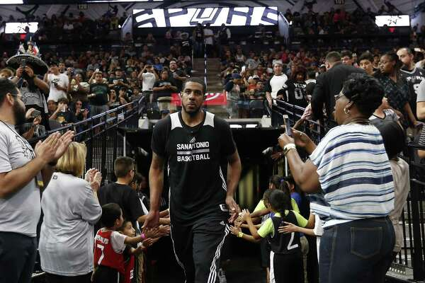 LaMarcus Aldridge greets fans at the Spurs' Silver & Black open scrimmage at the AT&T Center on Oct. 18, 2016.