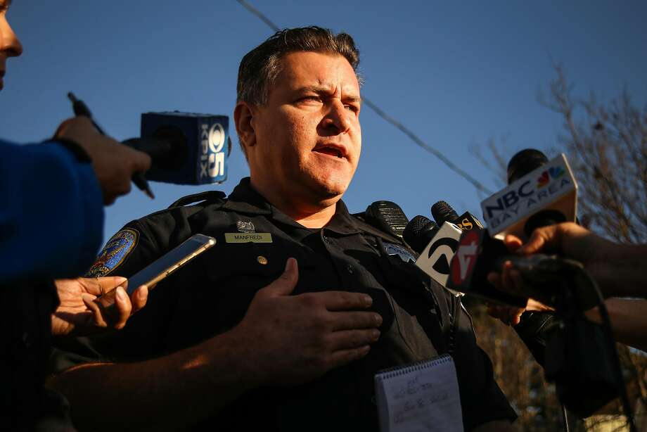 Officer Carlos Manfredi addresses the media. Photo: Joel Angel Juárez / Special To The Chronicle