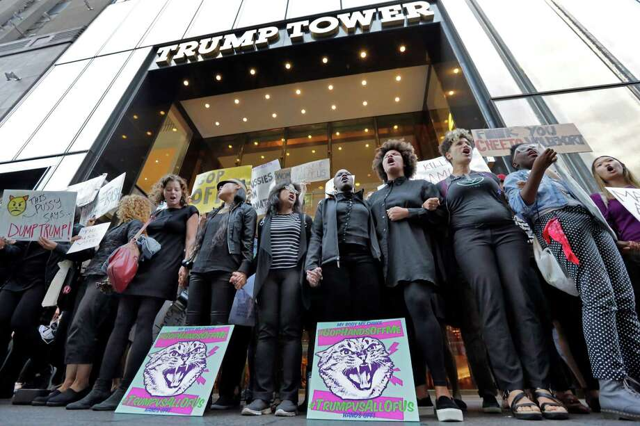 Women protest Republican presidential candidate Donald Trump and the GOP in front of Trump Tower in New York, Tuesday, Oct. 18, 2016. (AP Photo/Richard Drew) ORG XMIT: NYRD101 Photo: Richard Drew / AP