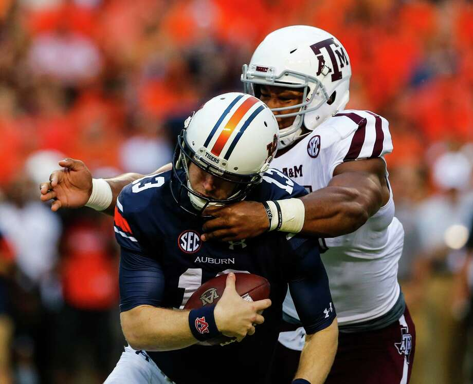 Auburn's Sean White becomes the victim of one of Myles Garrett's four sacks this season - a total likely held down by the A&M junior missing action with a leg injury. Photo: Butch Dill, Stringer / 2016 Getty Images