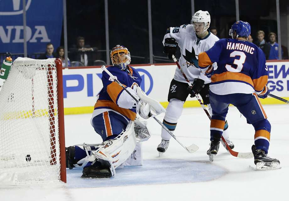 Islanders goalie Jaroslav Halak and the Sharks' Tomas Hertl watch Joe Pavelski's shot enter the net with 2:11 left to break a tie and lift San Jose to its third victory in four games this season. Photo: Frank Franklin II, Associated Press