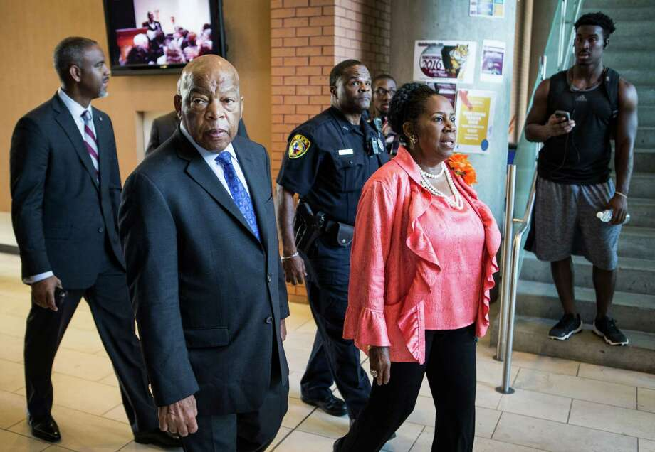 Rep. John Lewis, D-Georgia, second from left, and Rep. Sheila Jackson Lee, D-Houston, arrive Tuesday at a roundtable discussion on responsible gun safety legislation at Texas Southern University. Photo: Brett Coomer, Staff / © 2016 Houston Chronicle