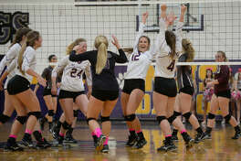 Midland High's Hayley Branco (12) celebrates with teammates after scoring against Lee on Tuesday, Oct. 18, 2016, at Midland High. James Durbin/Reporter-Telegram