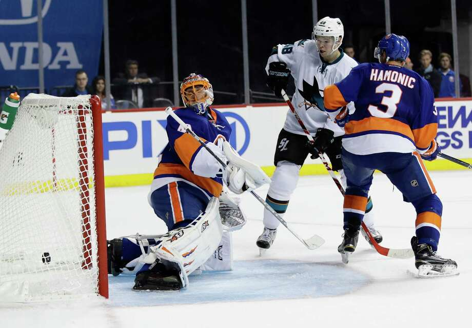 New York Islanders goalie Jaroslav Halak (41) watches the puck shot past him for a goal by San Jose Sharks' Joe Pavelski as Tomas Hertl (48) watches during the third period of an NHL hockey game, Tuesday, Oct. 18, 2016, in New York. The Sharks won 3-2. (AP Photo/Frank Franklin II) ORG XMIT: NYFF111 Photo: Frank Franklin II / Copyright 2016 The Associated Press. All rights reserved.