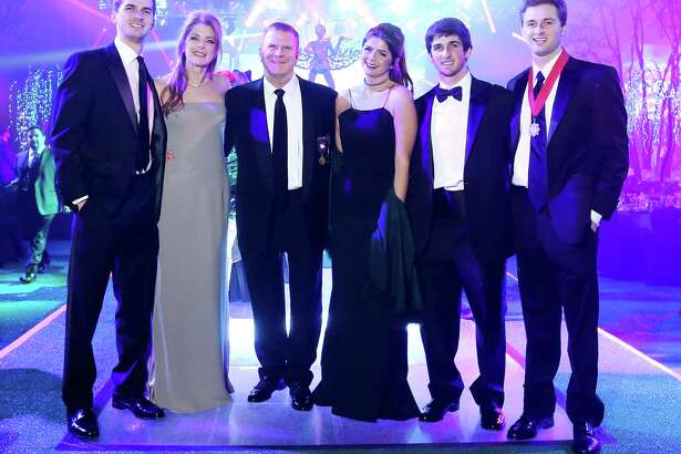 Michael, Paige, Tilman, Blayne, Blake and Patrick Fertitta pose for a photo at San Luis Salutes Gotham City