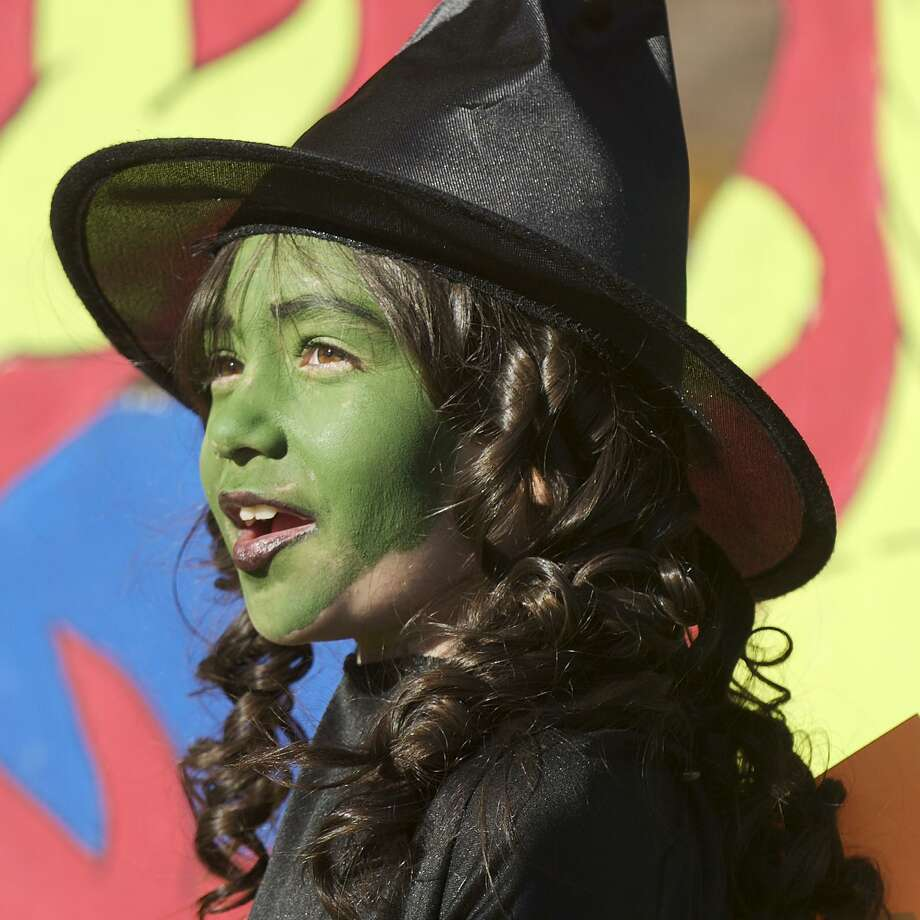 A young Wicked Witch of the West attends a Halloween event in Danbury, in 2013. A recent study shows there can be some creepy stuff lurking in cosmetic products aimed at children. Photo: H John Voorhees III /file Photo / The News-Times