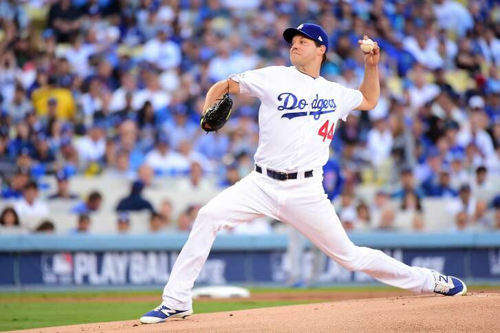 LOS ANGELES, CA - OCTOBER 18:  Rich Hill #44 of the Los Angeles Dodgers pitches in the first inning against the Chicago Cubs in game three of the National League Championship Series at Dodger Stadium on October 18, 2016 in Los Angeles, California.  (Photo by Harry How/Getty Images)